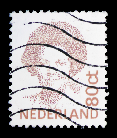 MOSCOW, RUSSIA - FEBRUARY 10, 2019: A stamp printed in Netherlands shows Queen Beatrix, Type Inversion serie, circa 1996