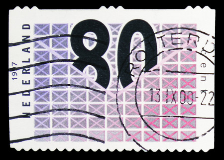 MOSCOW, RUSSIA - FEBRUARY 10, 2019: A stamp printed in Netherlands shows Stylized letters, Business post serie, circa 1997 Sajtókép