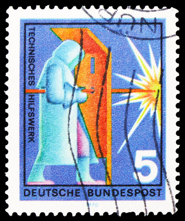 MOSCOW, RUSSIA - FEBRUARY 20, 2019: A stamp printed in Germany, Federal Republic, shows Welder, Voluntary Relief Services serie, circa 1970