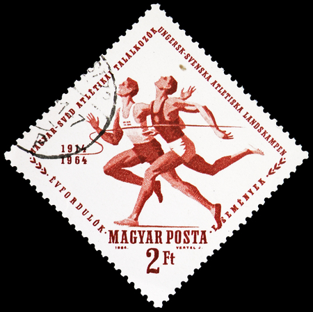 MOSCOW, RUSSIA - FEBRUARY 21, 2019: A stamp printed in Hungary shows Runners, Sport serie, circa 1964 Редакционное