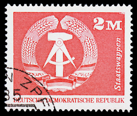 MOSCOW, RUSSIA - FEBRUARY 21, 2019: A stamp printed in Germany, Democratic Republic shows National Coat of Arms, Construction in the GDR, large format serie, circa 1973 Editorial