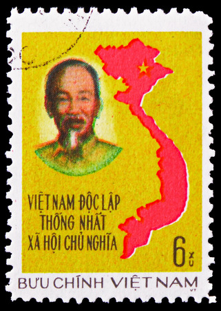 MOSCOW, RUSSIA - FEBRUARY 21, 2019: A stamp printed in Vietnam shows Ho Chi Minh and map from Vietnam, Unification of Vietnam serie, circa 1976
