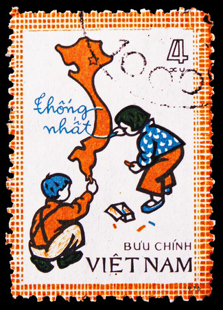 MOSCOW, RUSSIA - FEBRUARY 21, 2019: A stamp printed in Vietnam shows Children drawing map of unified Viet Nam, serie, circa 1977