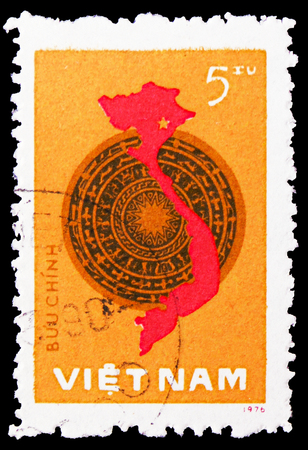 MOSCOW, RUSSIA - FEBRUARY 21, 2019: A stamp printed in Vietnam shows Bronze drum and map, National Assembley, general elections,1st anniversary serie, circa 1977 Editorial