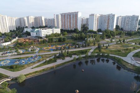 Wide angle view on Gavrikovskiy pond and Butovo park, Moscow, Russia. Drone flight image