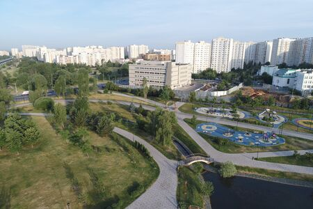 Wide angle view on Gavrikovskiy pond and Butovo park, Moscow, Russia. Drone flight image Imagens - 126106938