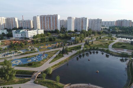 Wide angle view on Gavrikovskiy pond and Butovo park, Moscow, Russia. Drone flight image Imagens - 126106943