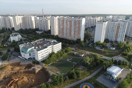 Wide angle view on Real Estate buildings on Gorchakova street and Butovo park from the birds sight, Moscow, Russia. Drone flight image