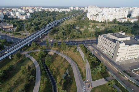 Wide angle view on Subway station Ulitsa Gorchakova and Butovo park from the birds sight, Moscow, Russia. Drone flight image Imagens - 126107202