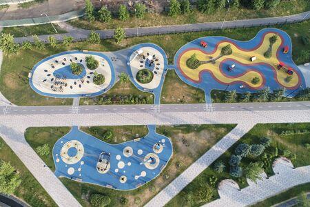 Wide angle view on Kids attractions area in Butovo park from the birds sight, Moscow, Russia. Drone flight image
