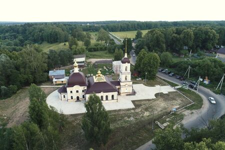 Aerial view of Church Of The Nativity Of The Blessed Virgin, Nikolskoye village, Kaluga region, Russia Imagens - 126116498