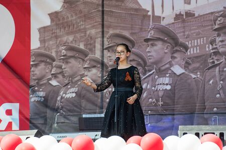 MOSCOW, RUSSIA - MAY 9, 2019: Khasanova Alina sing a song on a scene during event dedicated to Victory Day on May 9, 2019