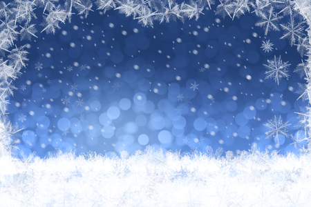 Beautiful blue blurred Christmas winter background with snow landscape Stock Photo