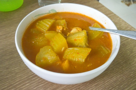 Hot and sour soup with Luffa. Stock Photo