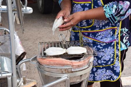 briquettes: Grilled squid at Chanthaburi Thailand. Stock Photo