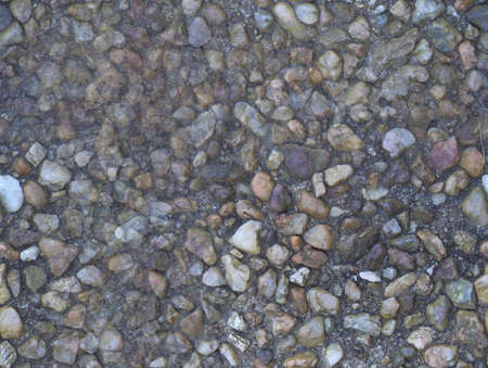 Small stones embedded in a walkway suitable for seamless background or wallpaper Stock Photo - 2388329