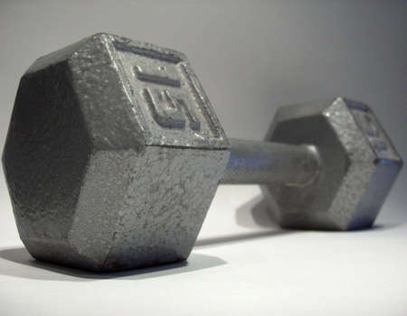 lb: 15 LB dumbbell isolated on gradient white background