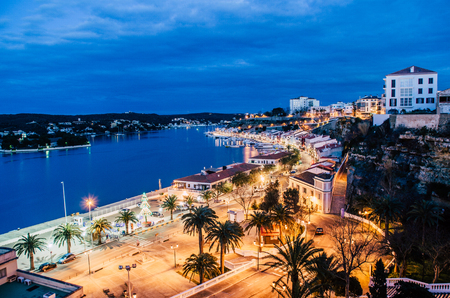 Photograph of a night landscape of the port of Maó, Menorca. One of the largest natural harbors in the world. Foto de archivo