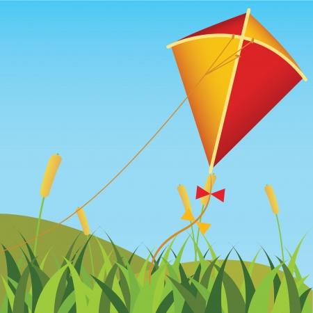 抽象フィールドの背景に赤と黄色の凧