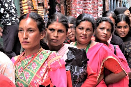 NEPAL BHAKTAPUR WOMEN LINED UP TO RECEIVE THE BLESSING DURIN THE TEEJ FESTIVAL 에디토리얼