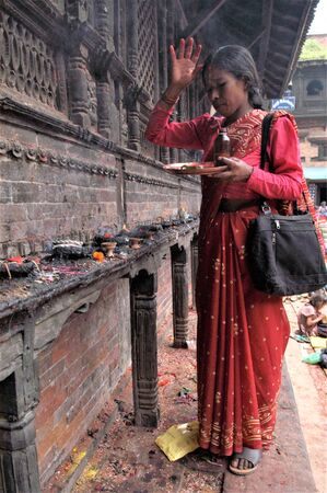 NEPAL BHAKTAPUR IN WOMAN IN PRAYER WAITING TO RECEIVE THE BLESSING DURING THE TEEJ FESTIVAL