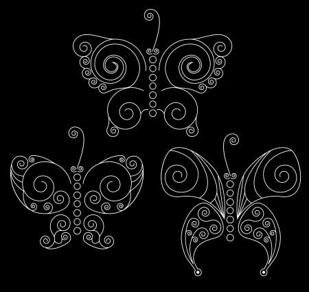 twee: Set of three white patterned butterflies on black background
