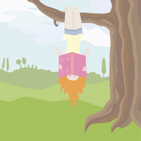 Girl is excited of reading hanging upside down an a tree branch