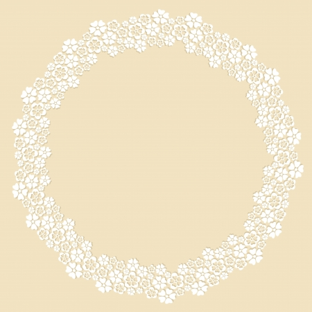 Round frame made of white paper cut flowers on beige background.