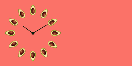 Half ripe green avocado with bone on the clock face with arrows as illustration time healthy lifestyle, emblem proper nutrition vegetarian diet bio brand quility restaurant. Copy space web banner