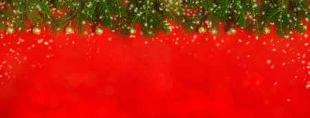Christmas decoration background with fresh natural branches of Christmas tree spruce on red paper background. Card concept. Closeup. Top view. Flat lay. Copy space. Web banner. Extra wide.