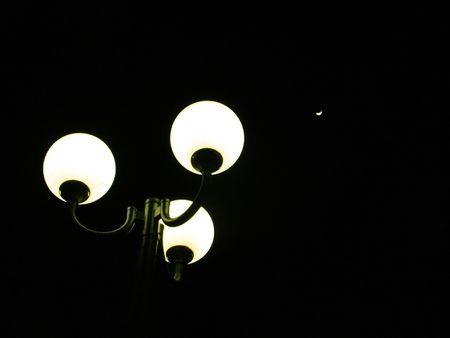 Street lamp with three bulbs photo