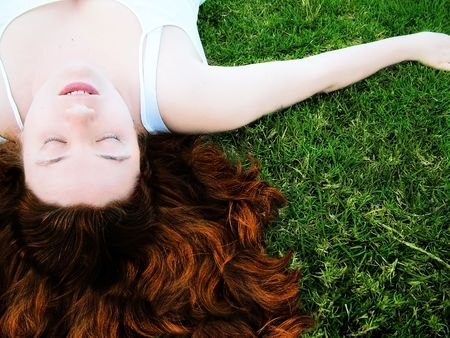Young woman sleeping in grass Stock Photo - 383421