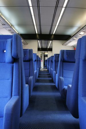 seating: Ground view of vacant seats inside a train during evening hours. Editorial