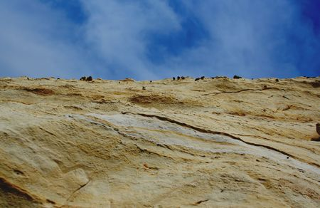 solidify: rock  with blue sky and clouds