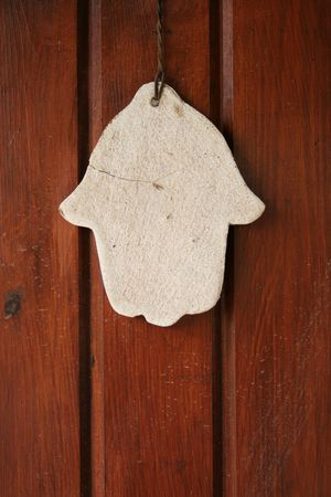 hamsa hand amulet, used to ward off the evil eye in mediterranean countries photo