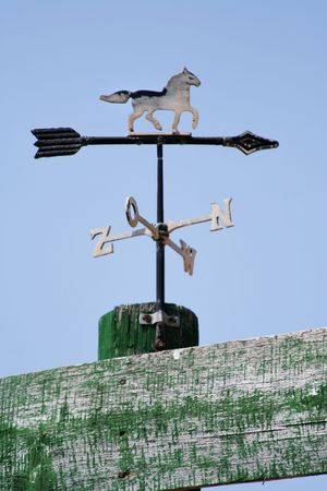 Weather vane with french directions photo