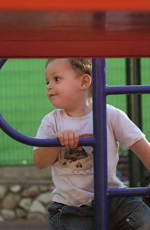 furtive: boy enjoys the playground Stock Photo