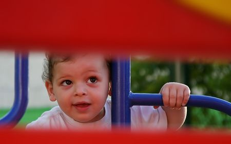 transom: boy enjoys the playground Stock Photo
