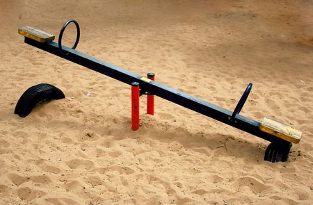 school playground: Part of a park.Children swing . Stock Photo