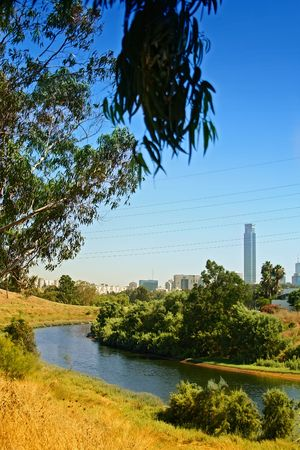 cumuli: Tel Aviv skyline, river walk and business district Stock Photo