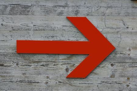 wander: Red   Arrow point the way Stock Photo