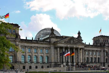 Reichstag Berlin, tourists in front of the building waiting in line to see big glass dom on the top
