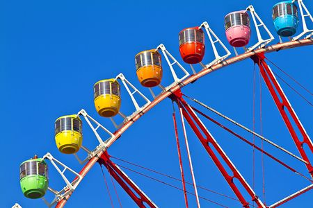 A multi coloured Tokyos Ferris Wheel with blue sky background photo