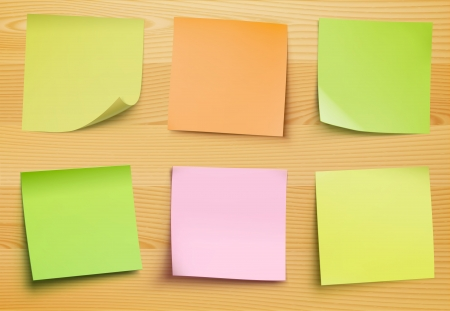 collection of post it notes in several colors on the wooden plate for your own text or image