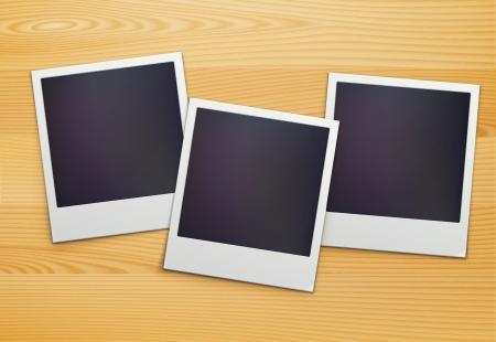 Vector illustration of three blank retro polaroid photo frames over wooden background