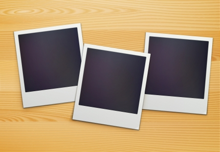 Vector illustration of three blank retro polaroid photo frames over wooden background Vector