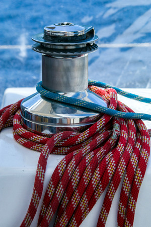 cordage: Sailboat winch and rope detail on yacht. Yachting.Sailboat detail Stock Photo