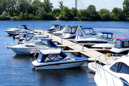 ship anchor: Docked boat. Boat mooring in the river port