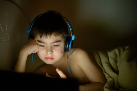boy influenced by late tv watching Stock Photo