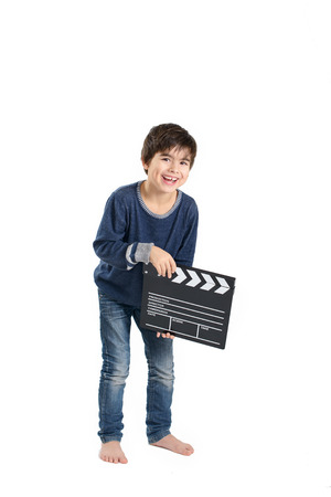 filmmaker: Cute boy is laughing keeping clapperboard Stock Photo